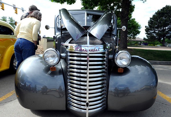 """Kathy and Jim Habenicht, left, look inside a 1940 Chevy truck owned by J.M. Isenhart.<br /> The 10th annual JDBR Streetrodders Car Show was held at Buenos Tiempos Restaurant in Broomfield on Sunday. For more photos of the show, go to  <a href=""""http://www.broomfieldenterprise.com"""">http://www.broomfieldenterprise.com</a> or  <a href=""""http://www.dailycamera.com"""">http://www.dailycamera.com</a>.<br /> Cliff Grassmick / May 6, 2012"""