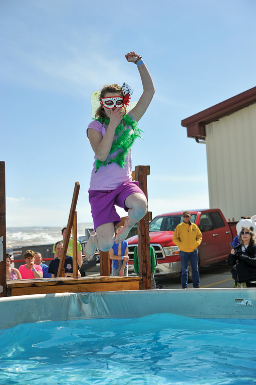 Ashleigh Fox | The Sheridan Press<br /> Daelynn Curdt flies off the platform at the Jackalope Jump Saturday, March 17, 2018. Curdt dressed for the occasion and jumped for the Masters Special Olympics team.