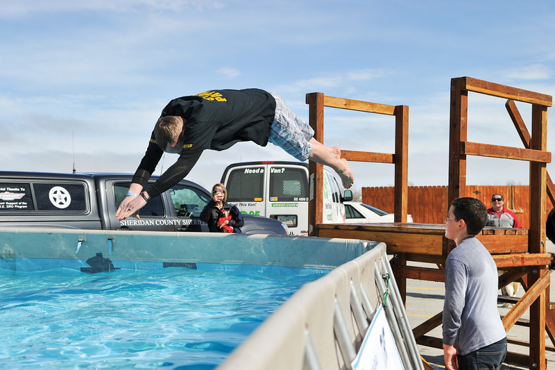 Ashleigh Fox | The Sheridan Press<br /> Wyoming Highway Patrol Lt. Erik Jorgensen dives into the water for the Jackalope Jump Saturday, March 17, 2018. The jump raises funds for local Special Olympics teams each year.