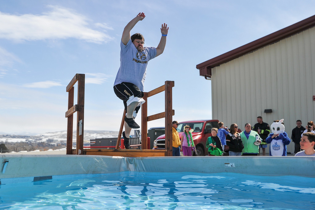 Ashleigh Fox | The Sheridan Press<br /> Allen Mayzak jumps into the pool for the Jackalope Jump at Goose Valley Fire Department Saturday, March 17, 2018. Mayzak earned second for top fundraising efforts for local Special Olympics teams.