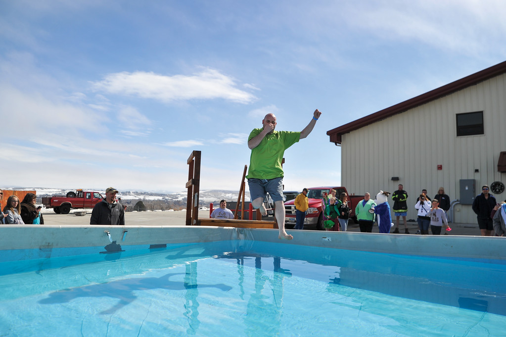 Ashleigh Fox | The Sheridan Press<br /> Doug Williams, an athlete with the Easter Seals Special Olympics team in Sheridan, was the first to jump into the icy waters of the pool for the Jackalope Jump at Goose Valley Fire Department Saturday, March 17, 2018. Williams raised $1,400 for local teams.