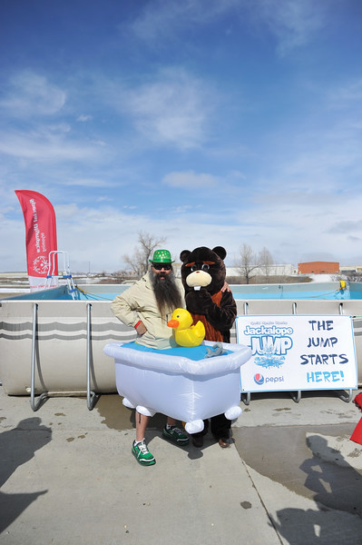 Ashleigh Fox | The Sheridan Press<br /> Pat Tarver poses with one of the Special Olympics mascots, a beaver, at the Jackalope Jump Saturday, March 17, 2018. Participants raised $8,700 for local Special Olympics teams through the event.