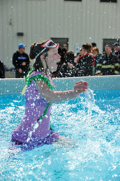 Ashleigh Fox | The Sheridan Press<br /> Daelynn Curdt reacts to the icy waters at the Jackalope Jump Saturday, March 17, 2018. Curdt dressed for the occasion and jumped for the Masters Special Olympics team.