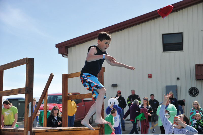 Ashleigh Fox | The Sheridan Press<br /> First-time jumper Jory Githens throws out a beanie before taking the plunge at the Jackalope Jump Saturday, March 17, 2018. Githens, representing the Masters Special Olympics team, jumped for his first time Saturday.