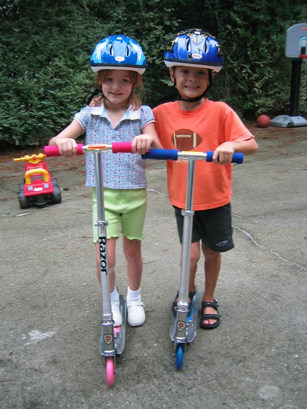 The twins loved their new scooters from Mom and Dad!