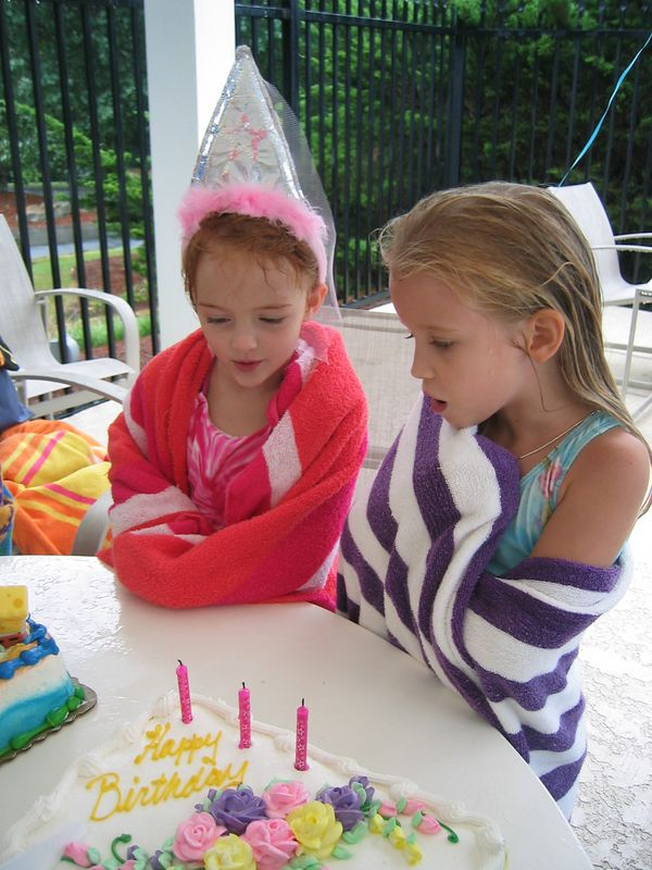 Caroline and Molly waiting patiently for the cakes to be cut.