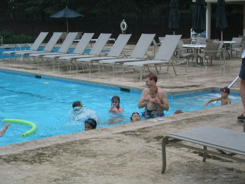 Doug entertained the kids by making up pool games.