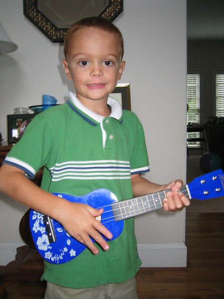 Jackson got this cool ukelele from Granddad and Nana.  They bought it on their recent trip to Hawaii.  Jackson LOVES it!  He had to put it on his nightstand so it would be close while he slept tonight.