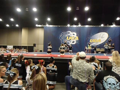 The lights came on in time for Elizabeth's big stunt.  She is stage right, being held up and waving to the crowd and LOVING it!
