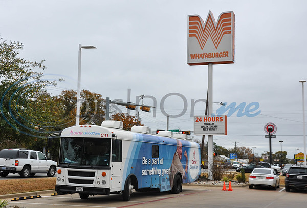 Two Carter BloodCare buses were stationed at the Whataburger in Jacksonville for the city's inaugural Battle of the Badges blood drive.  The event, sponsored by Whataburger, pitted the Jacksonville Police Department against the Jacksonville Fire Department in a friendly competition to see who could recruit the most blood donors. (Jessica T. Payne/Tyler Morning Telegraph)