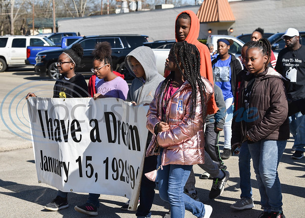 """Children hold a """"I have a dream"""" banner while participating in the Jacksonville Martin Luther King Jr. march on Monday, January 20. The march, hosted by the Jacksonville Unity Committee, began at 11:30 at the Norman Activity Center and ended at Sweet Union Baptist Church located at 302 N. Main Street. (Jessica T. Payne/Tyler Morning Telegraph)"""