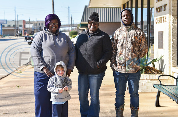 (From left) Eloise Williams, 40, Michall Williams, 42, Jamarious Hart, 16 and (front) Mason Bewere, 4, attend the Jacksonville Martin Luther King Jr. march on Monday, January 20. (Jessica T. Payne/Tyler Morning Telegraph)