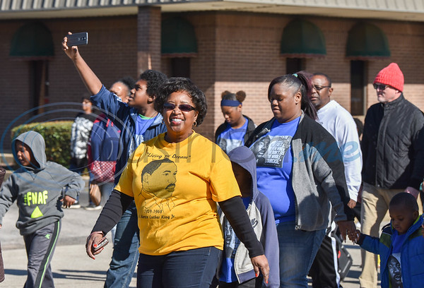 Jacksonville resident Janis Adams smiles while participating in the city's annual Martin Luther King Jr. march on Monday, January 20. The march started at the Norman Activity Center and ended at Sweet Union Baptist Church with a special service. (Jessica T. Payne/Tyler Morning Telegraph)