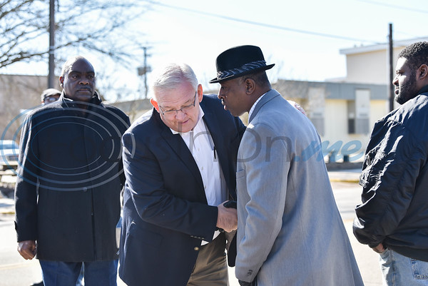 Jacksonville Mayor Randy Gorham shakes hands with St. Paul Baptist Church pastor Sedric Moore during the city's annual Martin Luther King Jr. march on Monday, January 20. Moore later spoke during a special serve for the event at Sweet Baptist Union Church. (Jessica T. Payne/Tyler Morning Telegraph)