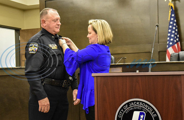 Jacksonville Police Chief Joe Williams gets pinned by his wife Amy at his swearing in ceremony at City Hall on Friday, February 7. (Jessica T. Payne/Tyler Morning Telegraph)