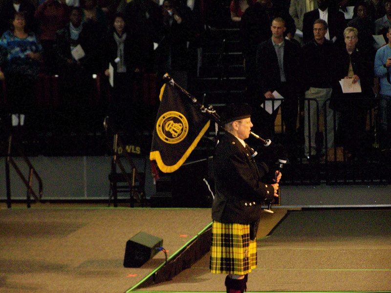 Procession is lead by bagpipes.