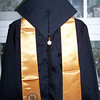 The graduate attire.