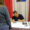 James signing my picture!