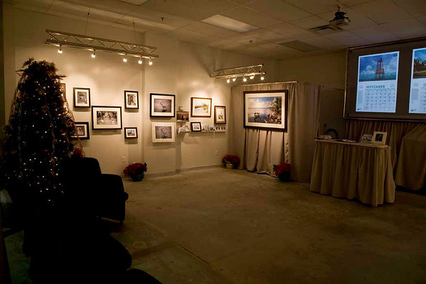 Slide show displays the pages of our 2009 Lighthouses of Florida calendar on sale at the Midtown Event.