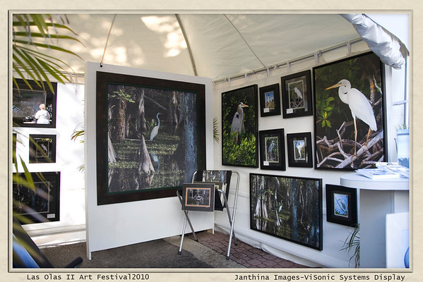 """ViSonic Systems and Janthina Images Collaborated on """"Art for Windows"""" at the Las Olas II Art Festival<br /> <br /> The Las Olas II Art Festival was held March 6th and 7th on a true """"chamber of commerce""""  weekend. More perfect weather for a stroll down an art venue could not have been ordered!! This Howard Alan Event was successful, highly organized, and very well attended.<br /> <br /> Janthina and ViSonic came together to present not only the art images of Janthina on art papers and canvas but also the Janthina """"Cypress Egret' scene on a Lutron motorized shading application. We had many visitors who thought this was a wonderful concept..beautiful and functional!! The remote control ,for demonstrating the function of the screen with its many preset positions and the motorized rear sheer sunshade,  was used so much we joked that we were hired to do lifetime button push testing on the device at the show. The shading and its electronics performed perfectly throughout and demonstrated how function and atmosphere through the use of art can enhance a room.<br /> <br /> Energy conservation has always been an important goal and today ever more so. Lutron Shading and Lighting solutions offered through ViSonic Systems's design and installation services works towards that goal through the management of both artificial and natural lighting.<br /> <br /> Janthina Images' calendars, cards, matted and framed prints, and new canvas items were well received, drew interest and many questions. It is always a pleasure to have the chance to talk photography, tell stories, and have the opportunity to meet new and existing patrons at such a beautiful venue.<br /> <br /> See you next time!!<br /> <br /> <br /> Note: This Image shows the screen fully down displaying the full screen image."""