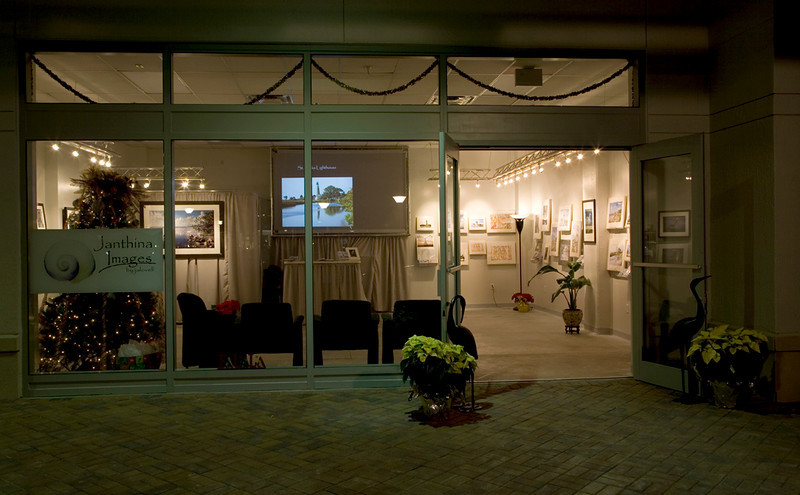 Night view of our front window. We had a slide show projecting our images and calendar pages and gave a dynamic sense to our display. Though some would say 'artistically bare'...its it still cozy.