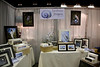 Our own personal 10 x 10 with framed and matted images on display.