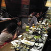 Tokyo, Watami Izakaya Restaurant, Patty Queener talks with Nao Kosaki.  Young professionals who were home stay students with the Rindsbergs enjoyed a fun evening with our group.