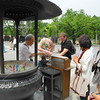 Tokyo, Ueno Park, Benten Shrine, Emilie Helman, Guerin Harris and Jeff Cox buy incense as an offering.