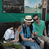 Kamakura, Jason Herzog reviews his photos with Patty Queener and Jeff Cox while waiting for the train to take them back to Tokyo.