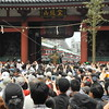 Tokyo, Asakusa, Sanja Matsuri, the crowd follows a mikoshi through the famous Kaminari Gate leading to Sensoji Temple.