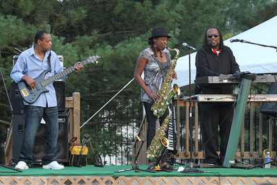 Opening act, female saxophonist Nadra Bingham, is joined on the stage by bass player Levi Patton, left, and keyboardist Rod Kelley.