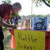 6/24/16 LEOMINSTER with story-  Leominster teacher Rick Miles signs up for raffle during Fridays fund raiser at Carter Park in Leominster for Jeff Rodriguez;  a Leominster native and victim of the Orlando shootings.  Sentinel & Enterprise photo/Jeff Porter