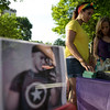 6/24/16 LEOMINSTER with story-  A photo of Jeff Rodriguez,  a Leominster native and victim of the Orlando shootings, sit's on the raffle table on Friday at Carter Park in Leominster.  Behind is close friend Tania Santiago and Lucia Santiago.  Sentinel & Enterprise photo/Jeff Porter