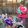 Alyssa White, 5, of Shirley looks for a good place to place a stuffed animal at the make shift memorial for Jeremiah Oliver on Saturday night. SENTINEL & ENTERPRISE/JOHN LOVE
