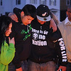 Jeremiah Oliver's cousin Sandro Oliver, center, with his girlfriend Gloria Delgado and Jason Oliver, Jeremiah's uncle take a moment at the make shift memorial for Jeremiah on Saturday night. SENTINEL & ENTERPRISE/JOHN LOVE