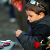 Miguel Feliciano Jr, 5, of Ayer places a toy car at the make shift memorial for Jeremiah Oliver on Saturday night. SENTINEL & ENTERPRISE/JOHN LOVE