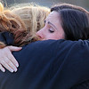 Tammy Arguelles and Dina Hammad hug at the make shift memorial for Jeremiah Oliver on Saturday night. SENTINEL & ENTERPRISE/JOHN LOVE