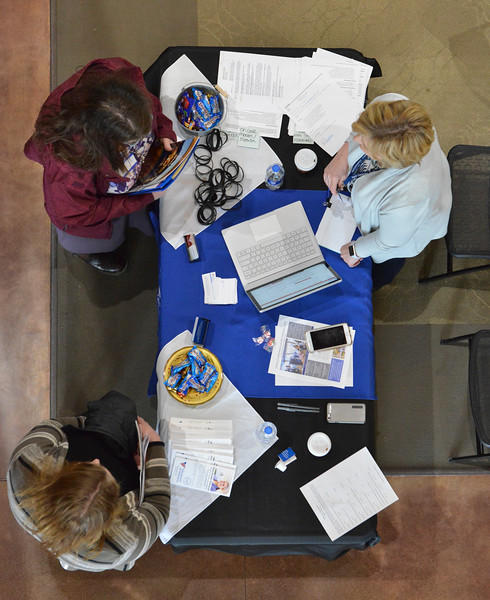 Justin Sheely | The Sheridan Press<br /> Job seekers visit an employer's booth during the Spring Career Network Fair at Sheridan College Wednesday, April 11, 2018.
