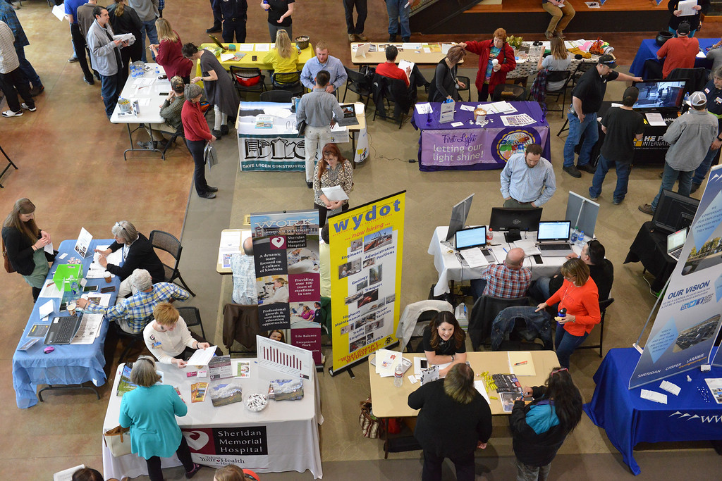 Justin Sheely | The Sheridan Press<br /> People visit employer booths during the Spring Career Network Fair at Sheridan College Wednesday, April 11, 2018.