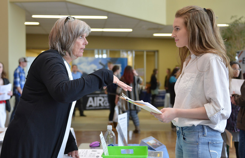 Justin Sheely | The Sheridan Press<br /> Terri Hayden, volunteer director at The Hub on Smith, left, visits with Big Horn High School junior Eva Swaney during the Spring Career Network Fair at Sheridan College Wednesday, April 11, 2018.