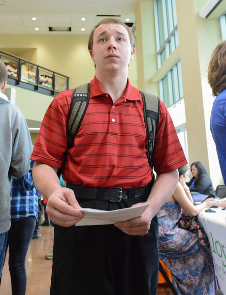 Justin Sheely | The Sheridan Press<br /> Big Horn High School sophomore Izack Brown looks over an employer directory during the Spring Career Network Fair at Sheridan College Wednesday, April 11, 2018.