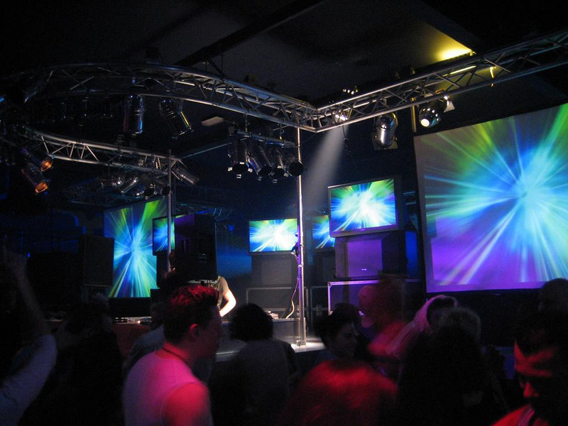 Big screens on the podium near the DJ