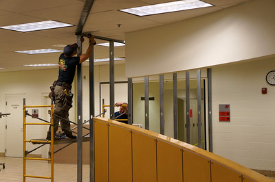 The construction team installs brackets for the temporary construction walls.  See a virtual tour of the new Jochum Performing Arts Center here: http://www.lutheranwest.com/UTS/Media-Gallery/Jochum-Architectural-Rendering