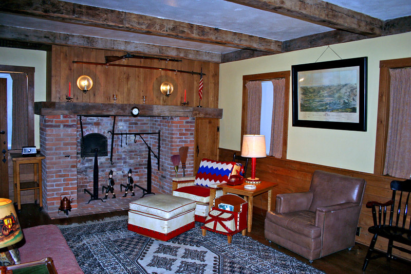 Den - Part of the preserved original farmhouse.  Civil War pike and musket above fireplace.  Ike read and played bridge here with friends.