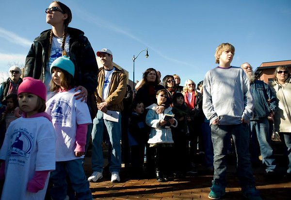 People stand and listen to speakers during the John Breaux Memorial Dedication ceremony in downtown Louisville, Saturday, Jan. 30, 2010. Breaux was killed one year ago to the date, and a statue honoring his memory was revealed in the downtown square.  <br /> KASIA BROUSSALIAN