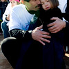 David Bright comforts his daughter, Shantel Bright, 6,  during the John Breaux Memorial Dedication ceremony in downtown Louisville, Saturday, Jan. 30, 2010. Breaux was killed one year ago to the date, and a statue honoring his memory was revealed in the downtown square.  <br /> KASIA BROUSSALIAN