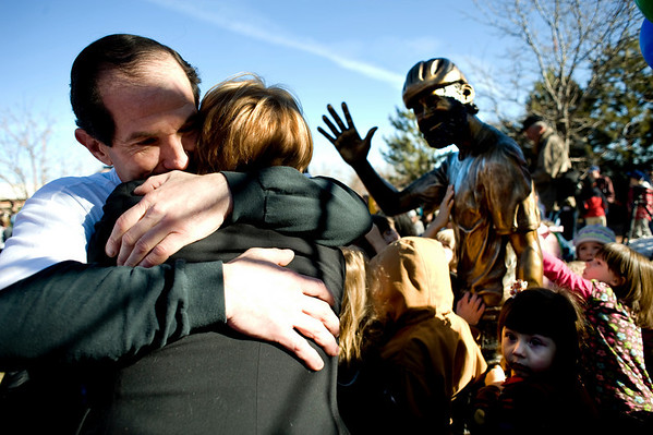 David Bright hugs sculptor Dawn Record after the unveiling of the memorial during the John Breaux Memorial Dedication ceremony in downtown Louisville, Saturday, Jan. 30, 2010. Breaux was killed one year ago to the date, and a statue honoring his memory was revealed in the downtown square.  <br /> KASIA BROUSSALIAN