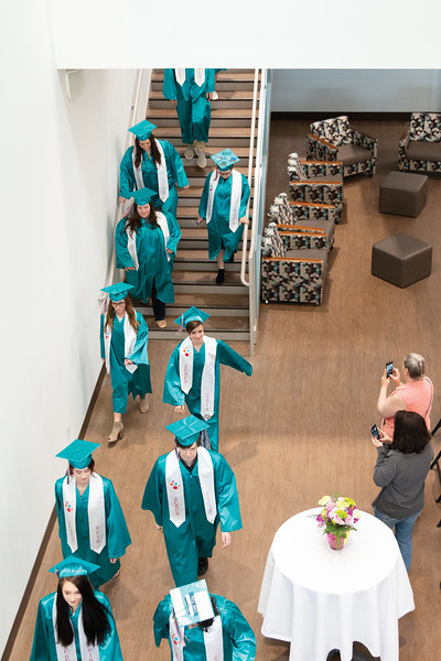 Matthew Gaston | The Sheridan Press<br>John C. Schiffer Collaborative School class of 2019 makes their way from the Nehjt Gallery to Kinnison Hall for graduation Saturday, May 25, 2019.