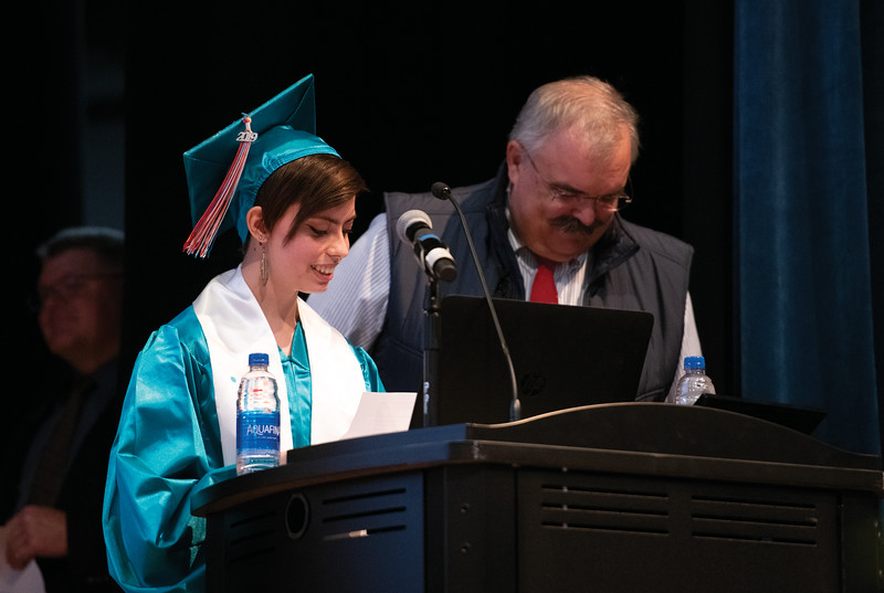 Matthew Gaston | The Sheridan Press<br>John C. Schiffer Collaborative School's 2019 valedictorian Mercy Duval delivers a speech with history teacher David Peterson by her side for moral support during commencement Saturday, May 25, 2019.