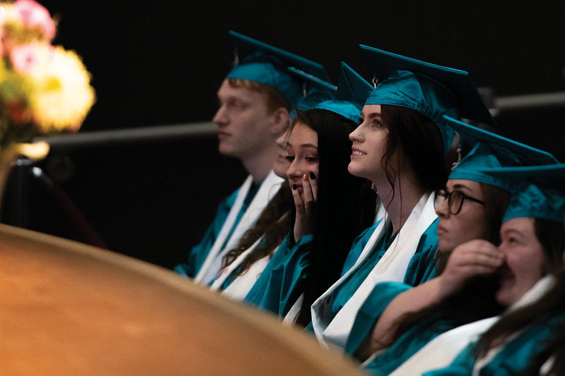 Matthew Gaston | The Sheridan Press<br>Myricle Stuart, center, smiles while watching a slide show during the John C. Schiffer School's commencement ceremony Saturday, May 25, 2019.